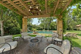 large backyard tropical house design with open patio cover and