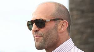 statham haircut maybe doing a melissa mccarthy comedy with paul feig will get