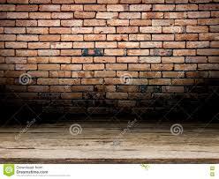 dark room wooden floor and brick wall background stock photo