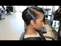 front and back views of chopped hair salon work meagan good inspired cut from natural to relaxed