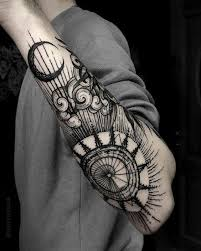 linework style cool painted forearm tattoo of big sun and moon