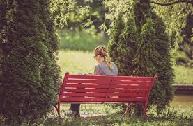 woman reading red park bench free stock photo negativespace