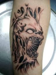 skull ripping through skin ripped skin tattoos torn skin