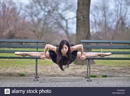 Asian Benches Asian Ballerina Wearing A Black Tutu Balancing Between Two Park