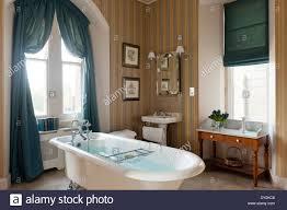 Striped Wallpaper Bathroom Free Standing Roll Top Bath In Bathroom With Striped Wallpaper And