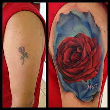 rose cover up tattoo by immortal ink