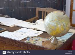 World Map Desk by Teacher U0027s Desk In Antique Classroom With Books And World Map Globe