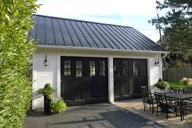 dream garage reveal black metal roof cape cod pumpkin lights