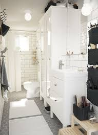 ikea bathroom ideas pictures a white medium size bathroom with two high cabinets with mirror