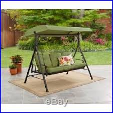 outdoor swing hammock green 3 person cushions backyard patio deck