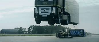 renault trucks watch a renault truck with trailer jump a speeding lotus f1 car