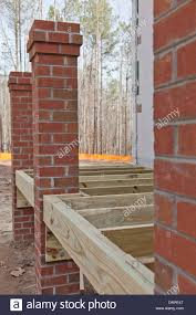 new home construction wood framing details of a porch with brick