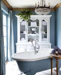 futuristic old world bathroom with white glass cabinet and oval