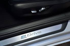 bmw group reveals its first hybrid vehicle