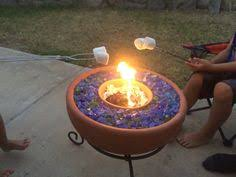 Glass Rocks For Fire Pit by Turn Your Old Lava Rock Into A Modern Glass Fire Pit Our Fire