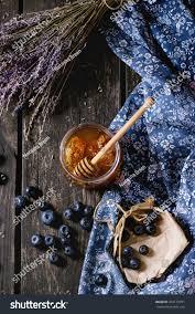 open glass jar liquid honey honeycomb stock photo 374123791
