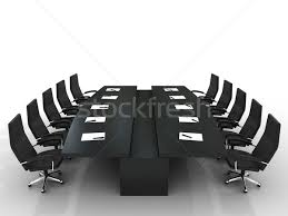 conference table and chairs with papers and pens stock photo