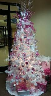 a breast cancer awareness christmas tree in the loving memory of