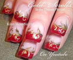 red and gold filigree nails design elegant red tip nail art