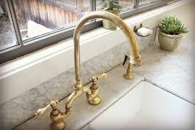 easton bridge gooseneck kitchen faucet with metal cross handles