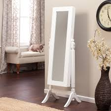 furniture brown mirror jewelry armoire plus wooden floor and rug