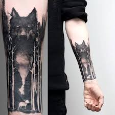watercolor forest with wolf mens negative space tattoos second