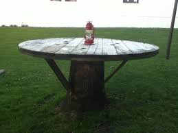 outdoor tables made out of wooden wire spools tree stump table made with large wire spool reusing pinterest