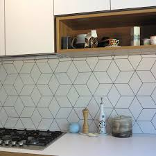 beautiful geometric tiled splashback white kitchen timber