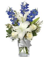 white and blue floral arrangements crisp winter skies flower arrangement vase arrangements flower