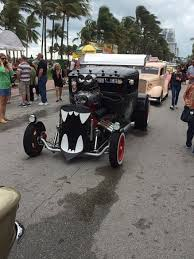 lots of antique cars on ocean drive for art deco weekend picture