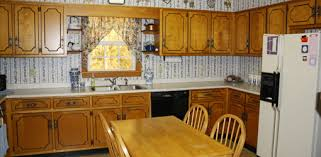 dated 1960s kitchen with plywood cabinets and plastic laminate