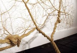 exquisite installations unwind strands of ropes into delicate trees