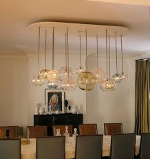 creative dining room lighting with aqua chandelier dining table