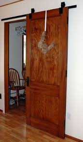 How To Make A Barn Door Track Diy Sliding Faux Barn Door Much Cheaper Than A Real Reclaimed