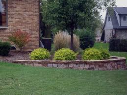 landscaping bi level home retaining wall on corner of brick