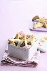 hamantaschen poppy seed closeup view of hamantaschen poppy seed filled pastries in tin box