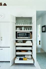 best 25 microwave in pantry ideas on pinterest big kitchen a concealed microwave and toaster on pull out shelves in architect sheila narusaa s cape cod