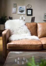 Distressed Leather Sofa by Dream Couch Distressed Leather Sofa Sheepskin Throw And Leather