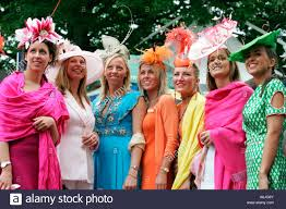 women in fancy hats at horse races royal ascot great britain