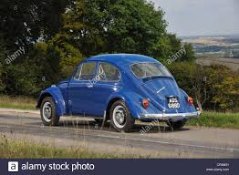 blue volkswagen beetle vintage 1966 vw volkswagen beetle classic stock air cooled bug stock photo