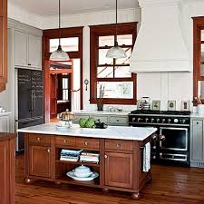 white kitchen cabinets wood trim easy breezy beautiful a house that keeps its cool