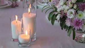 bridal bouquet holder table clip three lighting candles and bouquet of roses on wedding table stock