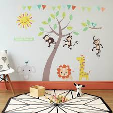 wall art stickers and decals notonthehighstreet com pastel jungle animal wall stickers children s room