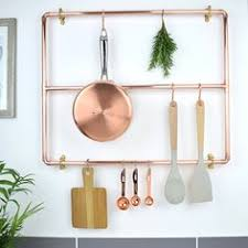 Designer Kitchen Utensils Make A Beautiful Bespoke Rack To Hang Kitchen Utensils Off From