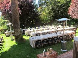 backyard wedding with rectangular tables and mahogany wood folding