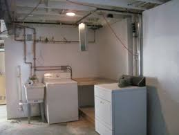 utility sink drain pump laundry sink cabinet over top a sump pump laundry sump jpg good