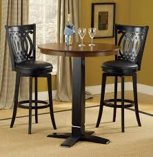 casual style dining room decor with 3 pieces round black pub table