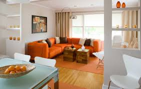 Small Living Room Decor by Orange Couch Living Room Ideas With Double Wooden Table Home