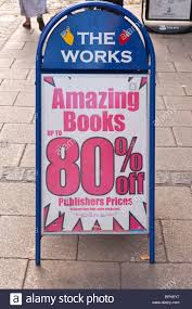 a sign advertising cheap books outside the works shop store in
