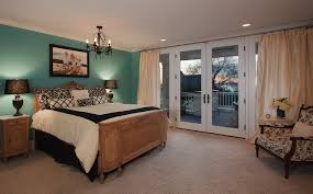 bedroom robins egg and pictures above bed with glass french door